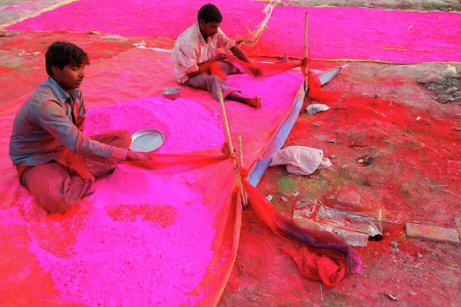 Indian laborers prepare colored powder for the upcoming festival, 'Holi' in Allahabad, India, Wednesday, March 20, 2013. 'Holi', the festival of colors will be celebrated on March 27.(AP Photo/ Rajesh Kumar Singh) Photo: Rajesh Kumar Singh, Associated Press / AP