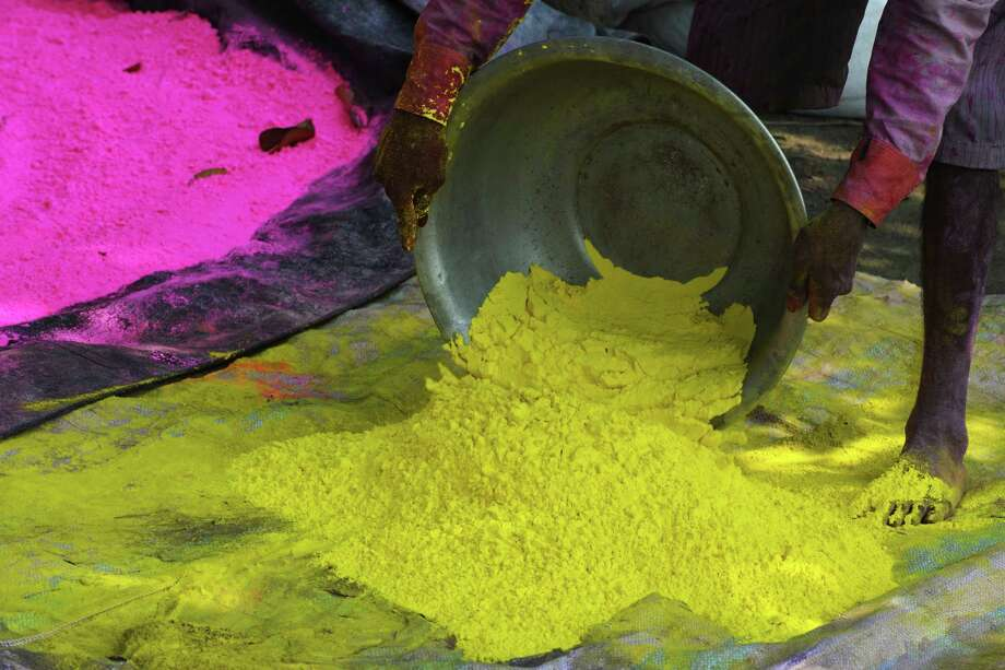 "An Indian labourer prepares colored powder, known as ""gulal"", to be used during the forthcoming spring festival of Holi, on the outskirts of Siliguri on March 20, 2013. Holi, the popular Hindu spring festival colours observed in India at the end of the winter season on the last full moon of the lunar month, will be celebrated March 27 this year. AFP PHOTO/Diptendu DUTTADIPTENDU DUTTA/AFP/Getty Images Photo: DIPTENDU DUTTA, AFP/Getty Images / AFP"