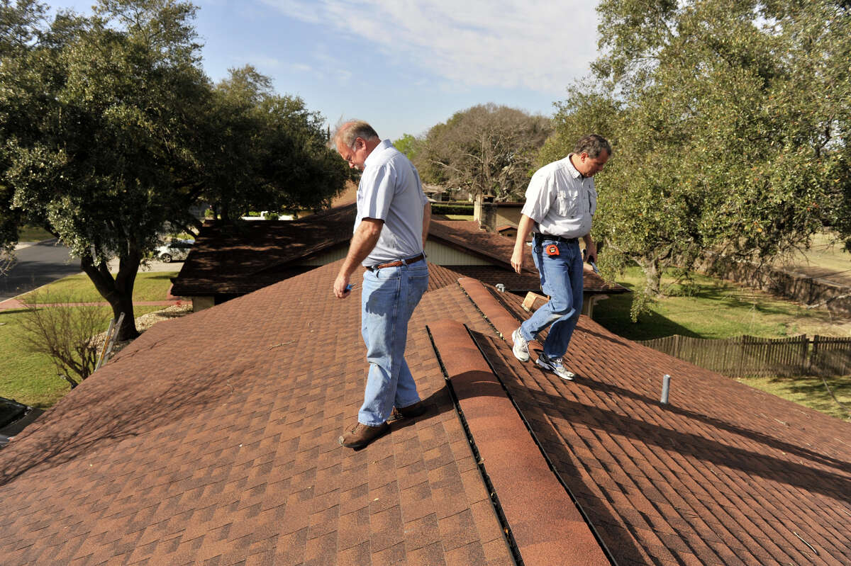 ROOFING The roof of a home is an important part of a home inspection that often needs repair as a result of age, or damage from storms or hail. In this photo, home inspectors Fred Buck (left) and Mark Eberwine, look over the roof of a Windcrest home.