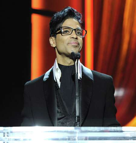 Prince speaks onstage at 2011 MusiCares Person of the Year Tribute to Barbra Streisand at Los Angeles Convention Center on February 11, 2011 in Los Angeles, California.  (Photo by Kevin Mazur/WireImage) Photo: Kevin Mazur, Getty Images / 2011 Kevin Mazur