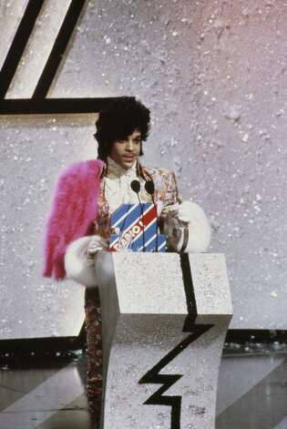 Prince collects the award for Best International Artist at the British Record Industry Awards, aka the BRIT Awards, held at the Grosvenor House Hotel in London, 11th February 1985. Photo: Georges DeKeerle, Getty Images / 2010 Georges DeKeerle