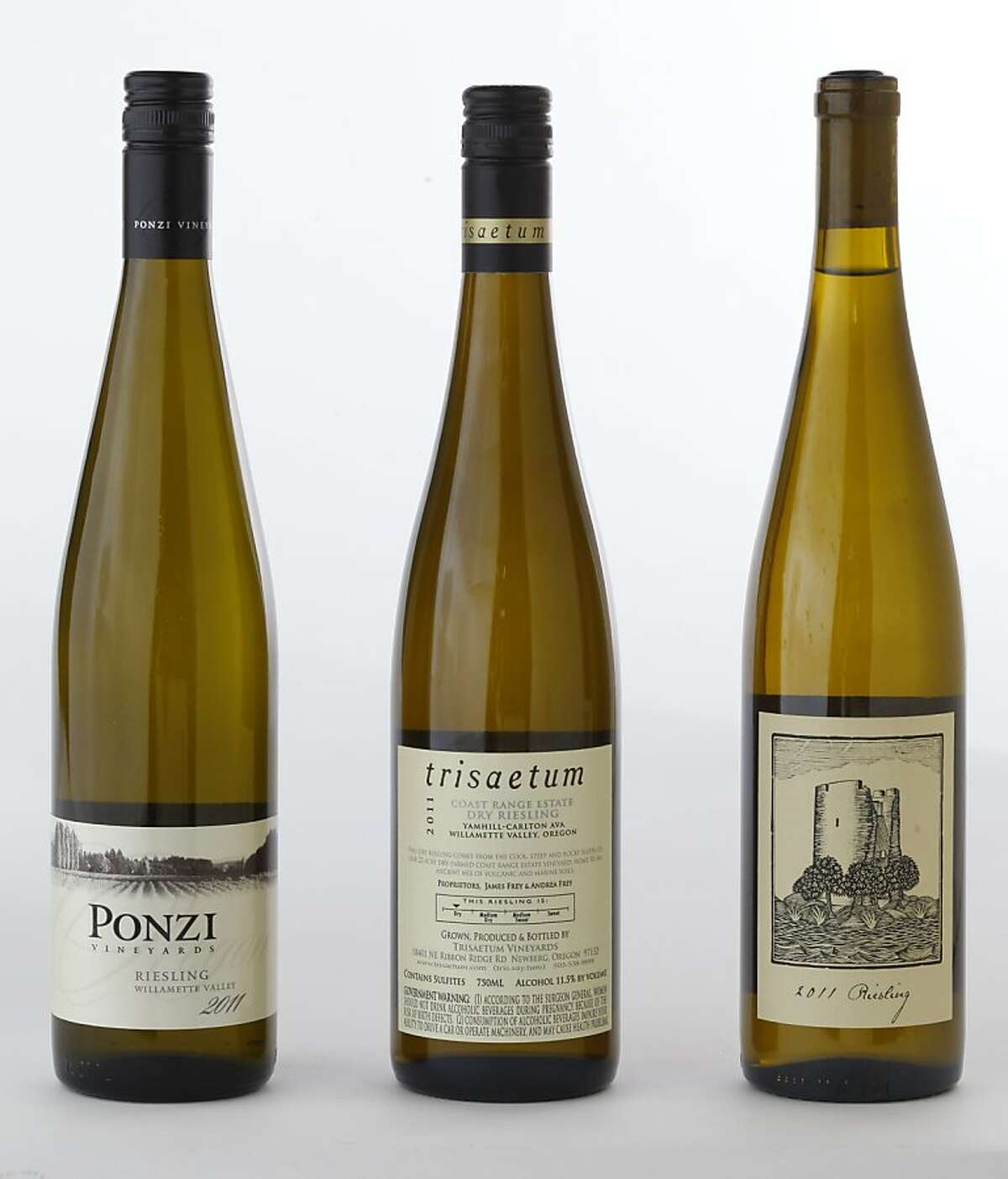 Left-right: 2011 Ponzi Willamette Valley Riesling, 2011 Owen Roe Yakima Valley Riesling, 2011 Trisaetum Coast Estate Yamhill-Carlton Dry Riesling as seen in San Francisco, California on Wednesday, March 20, 2013.