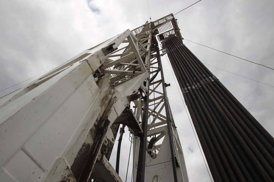 Drilling pipe is stacked on a rig near Tilden, Texas over the Eagle Ford shale formation. Rig numbers in the area south and east of San Antonio are increasing because of the ability to extract oil and gas by means of a process called hydraulic fracturing. (Tuesday March 22, 2011) JOHN DAVENPORT/jdavenport@express-news.net Photo: JOHN DAVENPORT, SAN ANTONIO EXPRESS-NEWS / jdavenport@express-news.net