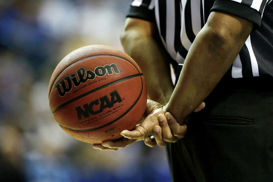 An official hold a NCAA basketball during a timeout during the first half of an NCAA college basketball game between Vanderbilt  and Kentucky at the Southeastern Conference tournament, Friday, March 15, 2013, in Nashville, Tenn. (AP Photo/Dave Martin) Photo: Dave Martin, Associated Press / AP