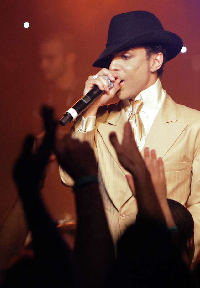 "Prince performs early 17 July 2007 during a jam session after his sold out concert at the 41th edition of the Montreux Jazz Festival. Prince's new album ""Planet Earth"" is due to go on sale next week.  AFP PHOTO / FABRICE COFFRINI Photo: FABRICE COFFRINI, Getty Images / 2007 AFP"