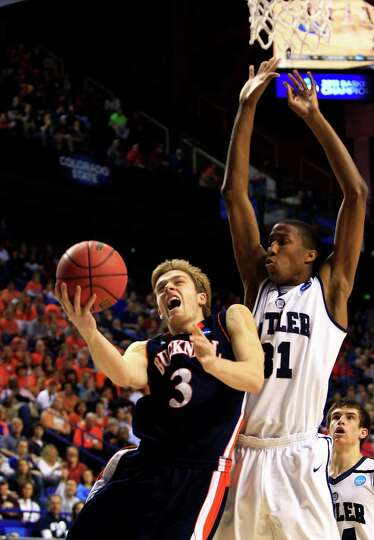 Bucknell guard Steven Kaspar (3) drives against Butler forward Kameron Woods (31) during the first h