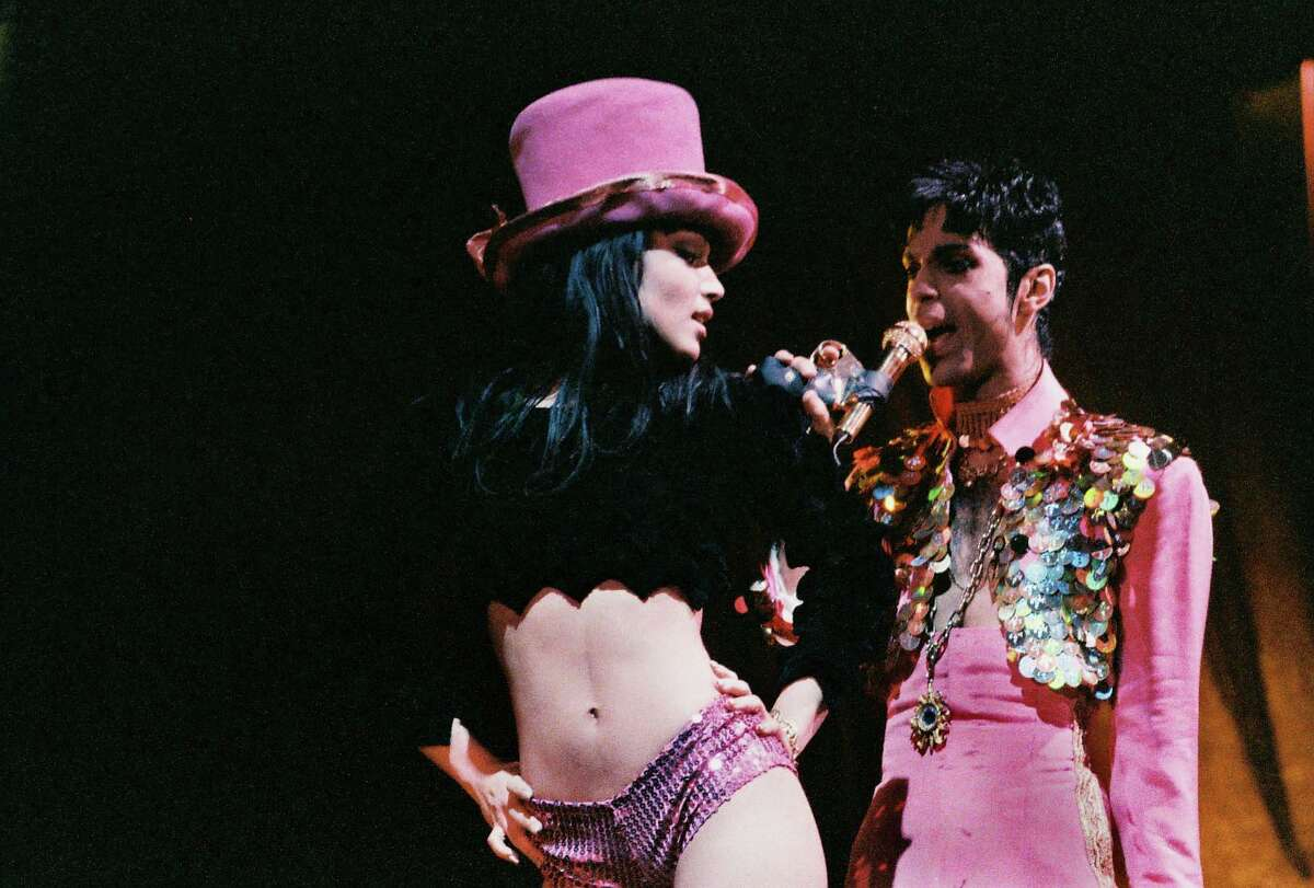 Mayte Garcia and Prince perform on stage on 'The Ultimate Live Experience' tour at Wembley Arena on March 4th, 1995 in London, United Kingdom. (Photo by Peter Still/Redferns)