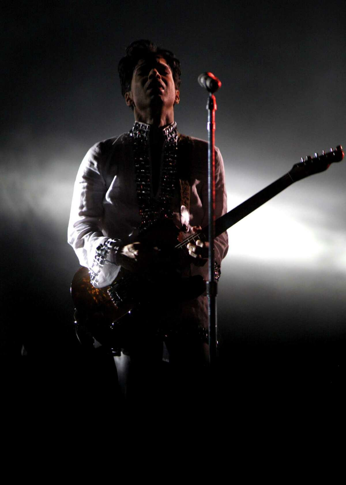 Prince performs at the Coachella Music And Arts Festival on April 26, 2008 at Empire Polo Grounds in Indio, California. (Photo by Barry Brecheisen/WireImage)