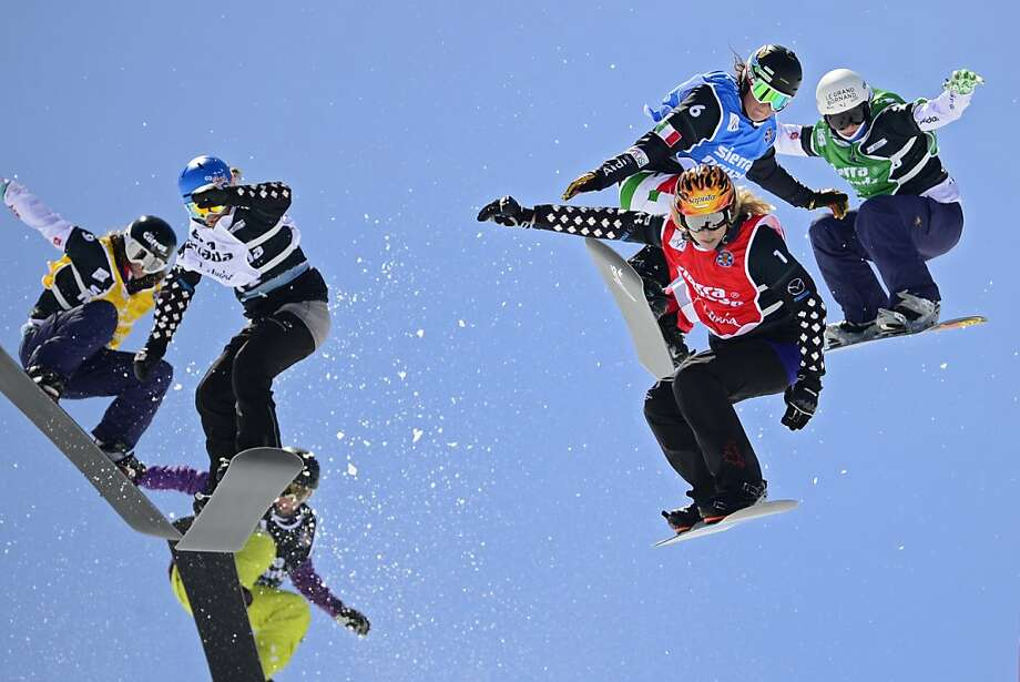 Flying cross: The Ladies' Snowboard Cross final at the FreeStyle World Cup in Sierra Nevada, Spain, looks like a collision waiting to happen, but amazingly these racers landed the jump unscathed. Photo: Javier Soriano, AFP/Getty Images