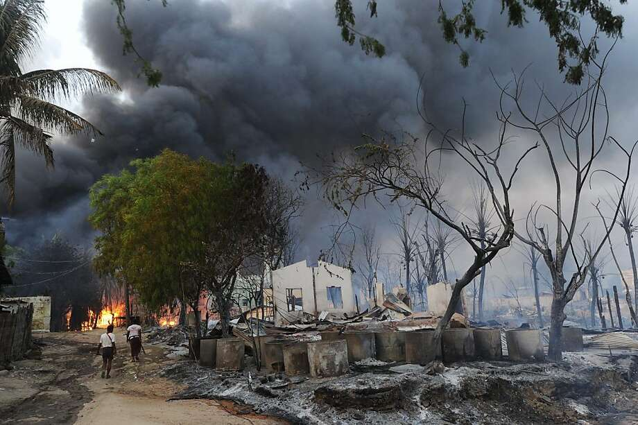 Smoke rises from burning buildings in riot-torn Meiktila, Myanmar. At least 10 people were killed in Buddhist-Muslim clashes. Photo: Soe Than Win`, AFP/Getty Images