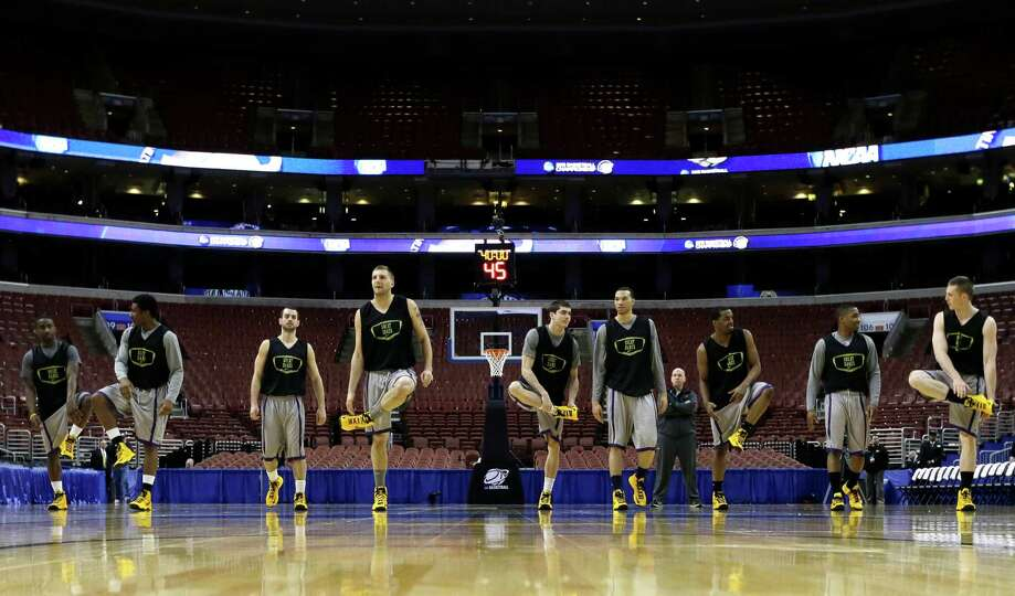 Albany players stretch during practice for a first-round game of the NCAA college basketball tournam