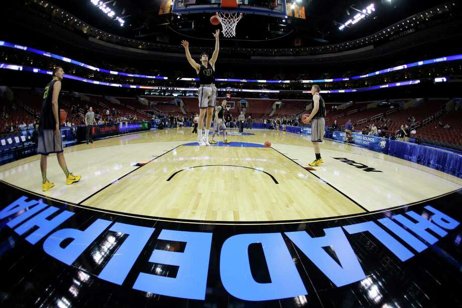 Albany's John Puk goes up for a shot during practice for a first-round game of the NCAA college basketball tournament, Thursday, March 21, 2013, in Philadelphia. Albany is scheduled to play Duke on Friday. Photo: Matt Slocum, AP / AP