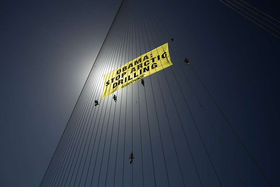 High-wire activism: Green Peace protesters climb cables of Jerusalem's Chords Bridge to raise a banner against Arctic drilling during President Obama's visit to Israel. Police arrested eight of the activists, including some who chained themselves to the bridge. Photo: Menahem Kahana, AFP/Getty Images