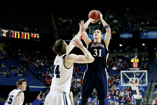 LEXINGTON, KY - MARCH 21:  Mike Muscala #31 of the Bucknell Bison shoots against Andrew Smith #44 of the Butler Bulldogs in the first half during the second round of the 2013 NCAA Men's Basketball Tournament at the Rupp Arena on March 21, 2013 in Lexington, Kentucky. Photo: Kevin C. Cox, Getty Images / 2013 Getty Images