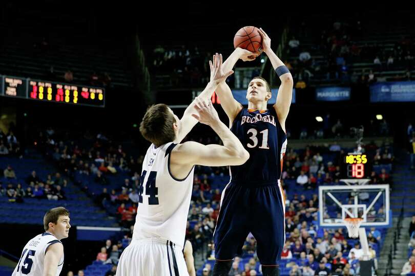 LEXINGTON, KY - MARCH 21:  Mike Muscala #31 of the Bucknell Bison shoots against Andrew Smith #44 of