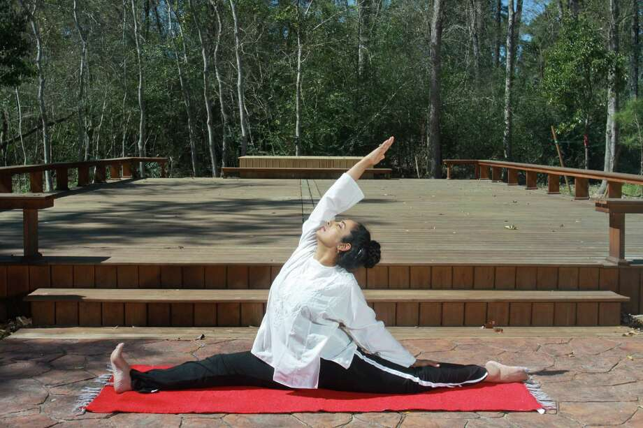 Sharon Kapp practices yoga at the Healing Tree: Houston Yoga & Ayurveda Wellness Center. Photo: Gary Fountain, Freelance / Copyright 2013 Gary Fountain.