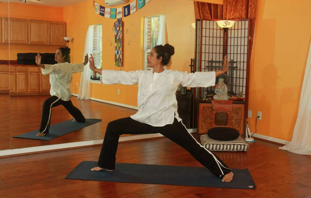 (For the Chronicle/Gary Fountain, March 11, 2013) Sharon Kapp practicing yoga at the Houston Yoga and Ayurveda Wellness Center.