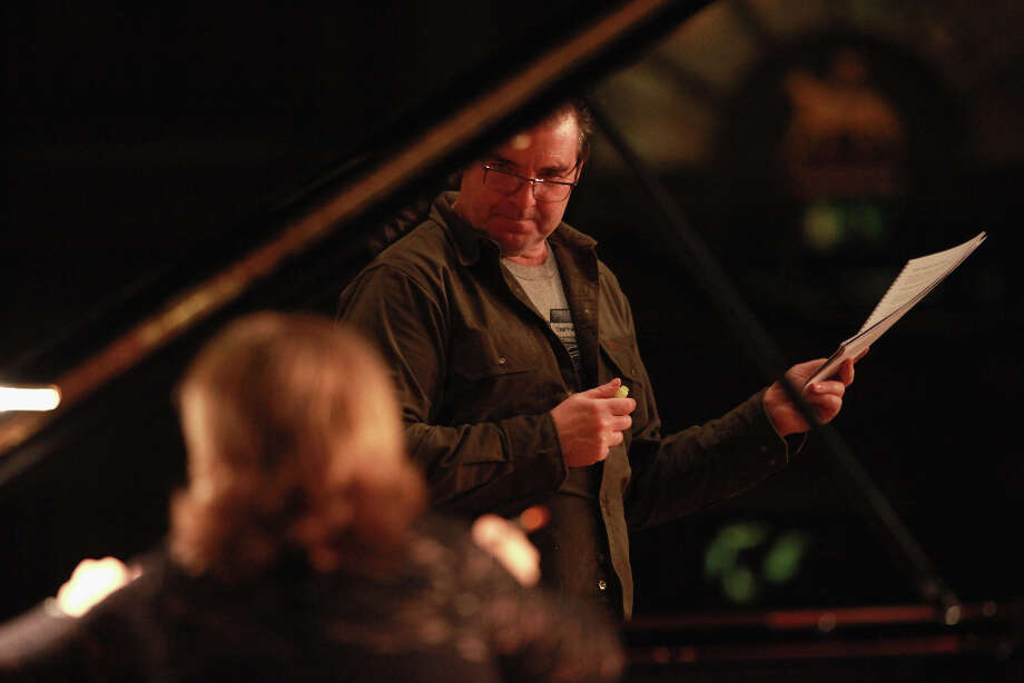 TV's 'Downton Abbey' actor Brendan Coyle portrays French composer Claude Debussy as pianist Lucy Parham plays piano works from 'Clair de Lune,' 'Reverie,' 'The Girl with the Flaxen Hair,' 'Jardins sous la pluie,' 'the Etudes' to 'L'isle joyeuse' during rehearsal at Middle Temple Hall on October 31, 2012 in London, United Kingdom. The biographical program, based on Debussy?s words and music, is in celebration of the 150th anniversary of his birth this year. Photo: Amy T. Zielinski, Redferns Via Getty Images / 2012 Amy T. Zielinski