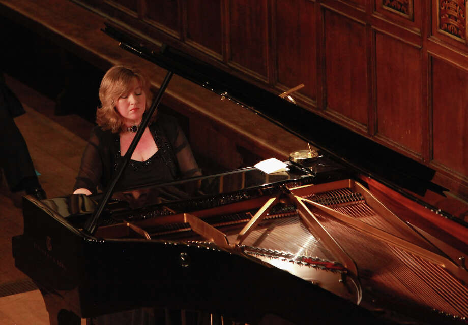 Pianist Lucy Parham plays piano works from 'Clair de Lune,' 'Reverie,' 'The Girl with the Flaxen Hair,' 'Jardins sous la pluie,' 'the Etudes' and 'L'isle joyeuse' as TV's 'Downton Abbey' actor Brendan Coyle portrays French composer Claude Debussy during a performance at Middle Temple Hall on October 31, 2012 in London, United Kingdom. The biographical program, based on Debussy?s words and music, is in celebration of the 150th anniversary of his birth this year. Photo: Amy T. Zielinski, Redferns Via Getty Images / 2012 Amy T. Zielinski