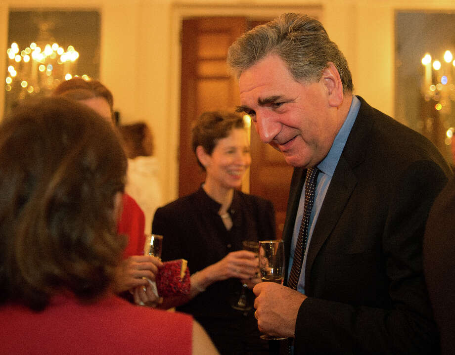 Actor Jim Carter, right, mingles with the crowd as he and a portion of the cast of Downton Abbey attended a reception in their honor for the upcoming 3rd season of their successful PBS TV show at the British Ambassador's Residence in Washington DC, December 14, 2012 .(Photo by John McDonnell/The Washington Post via Getty Images) Photo: The Washington Post, The Washington Post/Getty Images / 2012 The Washington Post