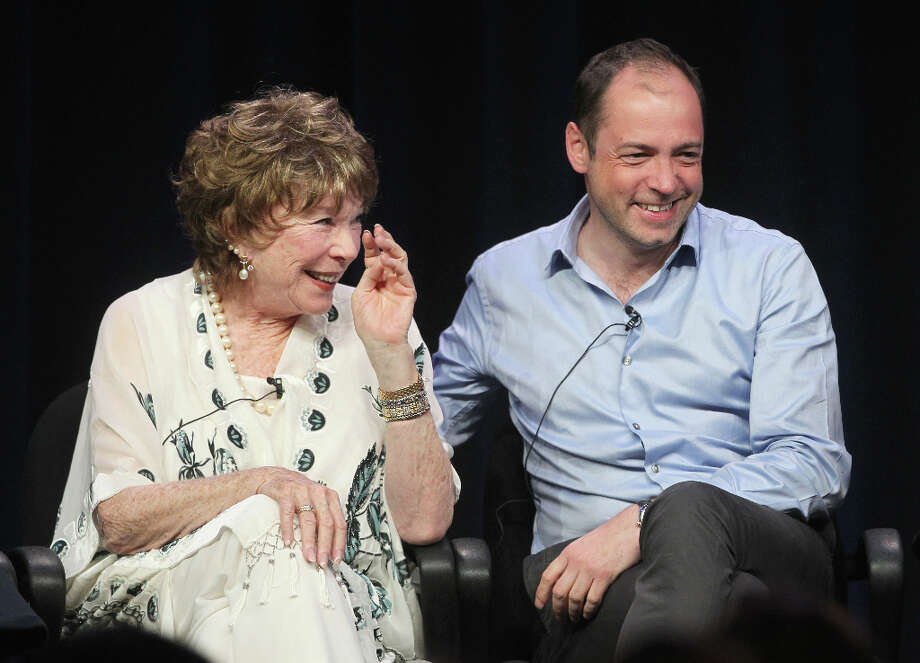 Actress Shirley MacLaine (L) and Executive Producer Gareth Neame speak onstage at the Masterpiece Classic Downton Abbey, Season 3 panel during day 1 of the PBS portion of the 2012 Summer TCA Tour held at the Beverly Hilton Hotel on July 21, 2012 in Beverly Hills, California. Photo: Frederick M. Brown, Getty Images / 2012 Getty Images