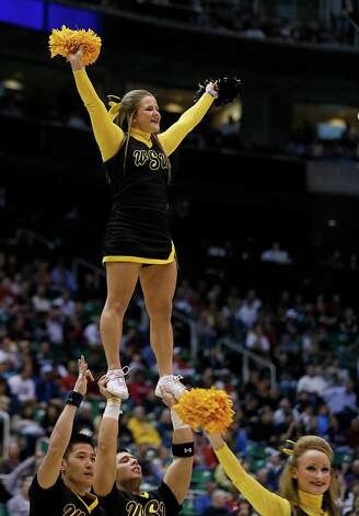 Wichita State cheerleaders perform during a second-round game in the NCAA college basketball tournament against Pittsburgh in Salt Lake City, Thursday, March 21, 2013. (AP Photo/George Frey) Photo: GEORGE FREY, Associated Press / FR10102 AP