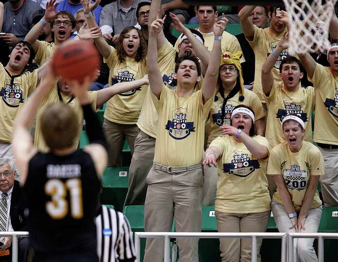 Pittsburgh fans try to distract Wichita State's Ron Baker as he shoots a free throw during a second-