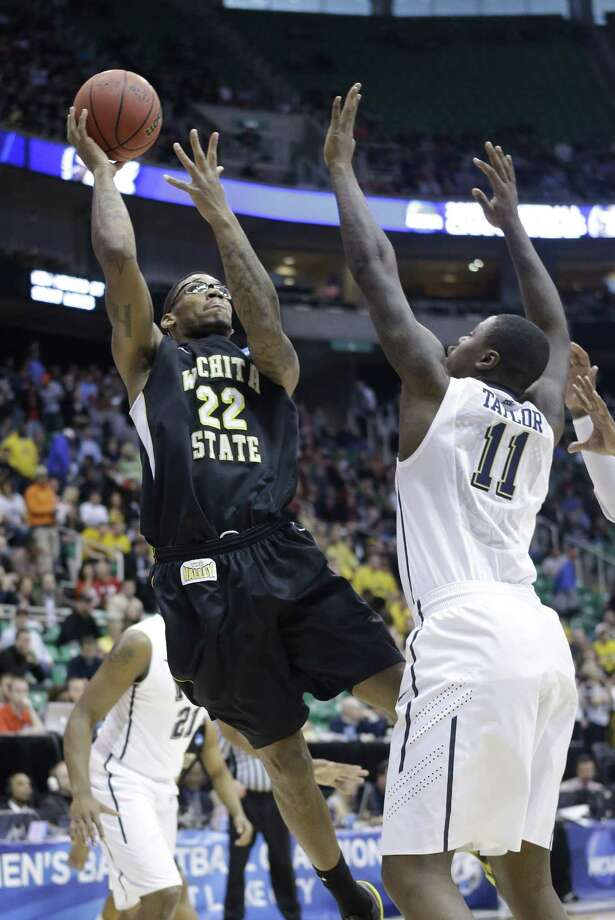 Wichita State 73, Pittsburgh 55Wichita State's Carl Hall (22) shoots as Pittsburgh's Dante Taylor (11) defends in the first half in Salt Lake City. Photo: Rick Bowmer, Associated Press / AP