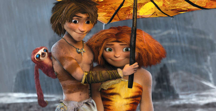 "This film publicity image released by DreamWorks Animation shows, from left, Belt the sloth, voiced by Chris Sanders, Guy, voiced by Ryan Reynolds, and Eep, voiced by Emma Stone, in a scene from ""The Croods."" (AP Photo/DreamWorks Animation) Photo: DreamWorks Animation"