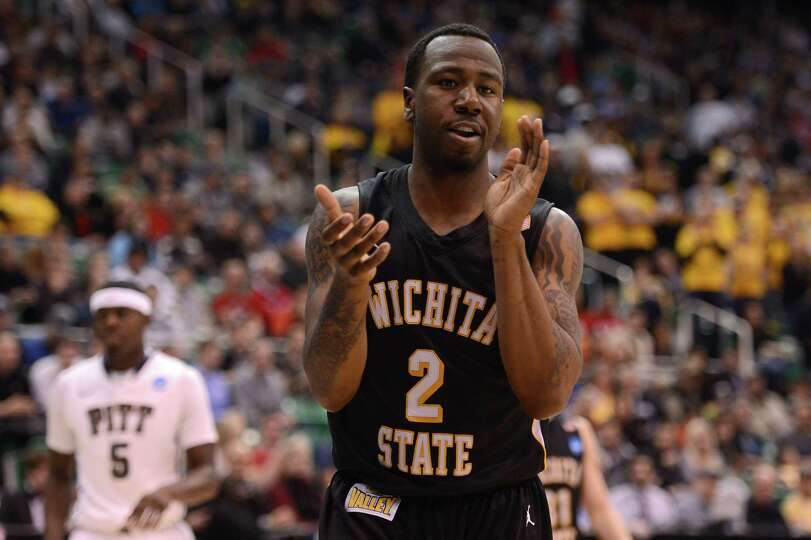 Malcolm Armstead #2 of the Wichita State Shockers celebrates after a foul was called on the Pittsbur