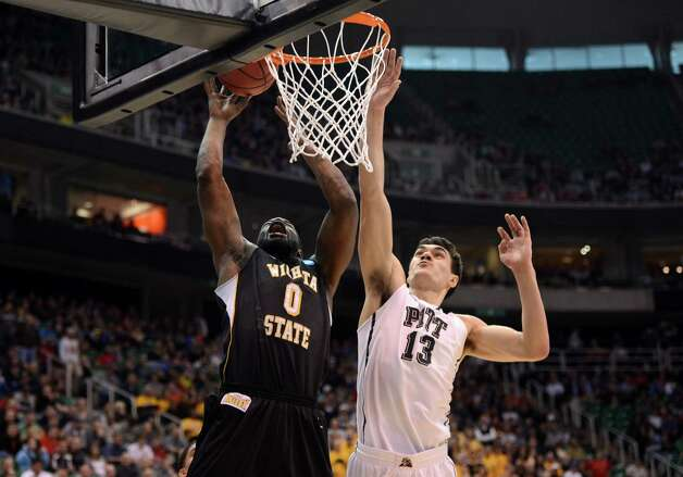 Chadrack Lufile #0 of the Wichita State Shockers scores on Steven Adams #13 of the Pittsburgh Panthers. Photo: Harry How, Getty Images / 2013 Getty Images