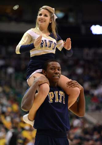 Pittsburgh Panthers cheerleaders perform during a break in the game against the Wichita State Shockers. Photo: Harry How, Getty Images / 2013 Getty Images