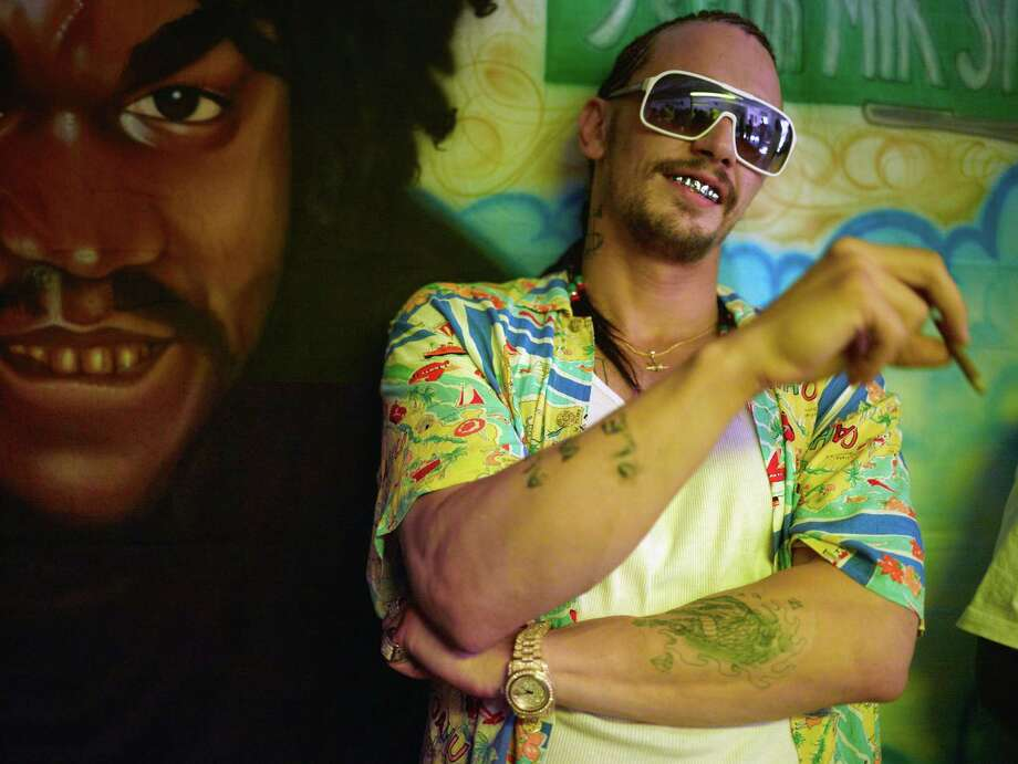 """This film image released by A24 Films shows James Franco in a scene from """"Spring Breakers."""" (AP Photo/A24 Films, Michael Muller) Photo: Michael Muller"""