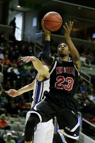 Daniel Mullings #23 of the New Mexico State Aggies goes up against Cody Ellis #24 of the Saint Louis Billikens. Photo: Ezra Shaw, Getty Images / 2013 Getty Images