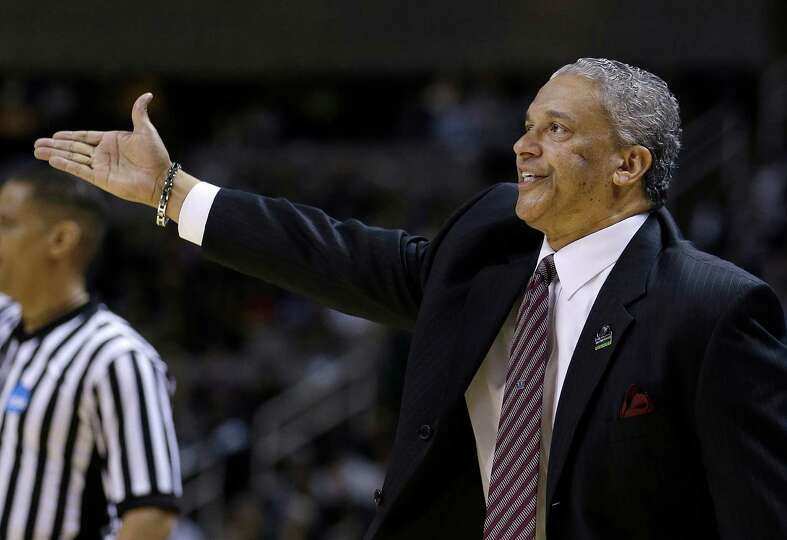 New Mexico State head coach Marvin Menzies gestures during the first half of a second-round game in