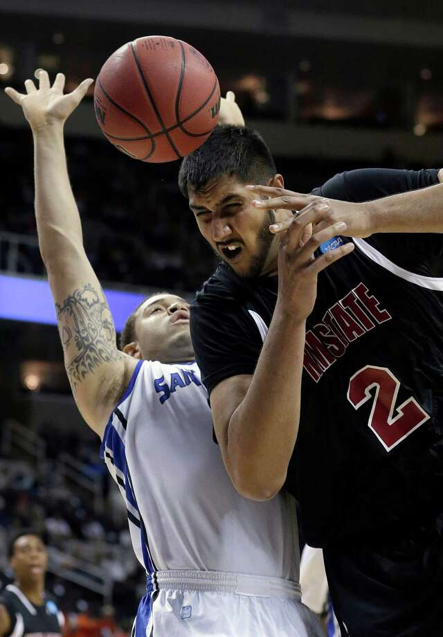 New Mexico State center Sim Bhullar (2) loses a pass in front of Saint Louis forward Grandy Glaze (1) during the first half of a second-round game in the NCAA college basketball tournament in San Jose, Calif., Thursday, March 21, 2013. (AP Photo/Jeff Chiu) Photo: Jeff Chiu, Associated Press / AP