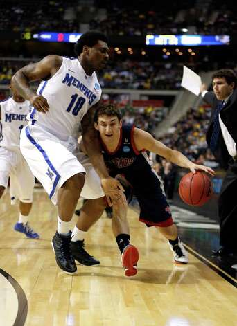 Jordan Giusti #12 of the St. Mary's Gaels drives in the first half against Tarik Black #10 of the Memphis Tigers. Photo: Gregory Shamus, Getty Images / 2013 Getty Images