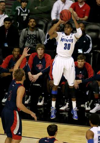 D.J. Stephens #30 of the Memphis Tigers attempts a shot in the first half against the St. Mary's Gaels during the second round. Photo: Jonathan Daniel, Getty Images / 2013 Getty Images