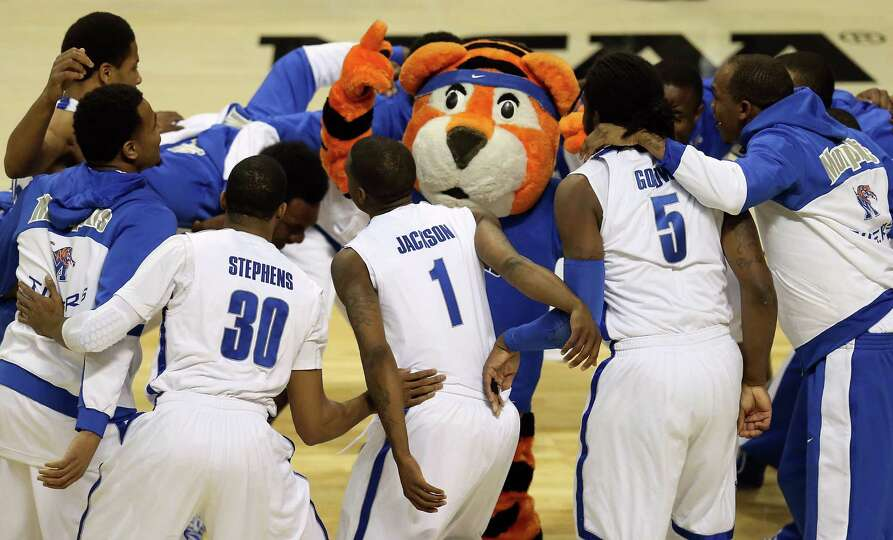 Players for the Memphis Tigers huddle around their mascot as they get set to play against the St. Ma
