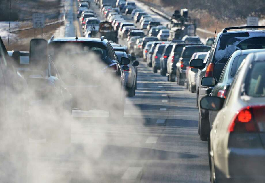 Car emissions are visible in the cold morning air as southbound traffic makes slow progress on the Northway Wednesday morning Jan. 23, 2013.  (John Carl D'Annibale / Times Union) Photo: John Carl D'Annibale / 00020877A
