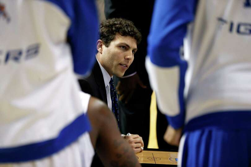 Head coach Josh Pastner of the Memphis Tigers talks to his players during a timeout against the St.