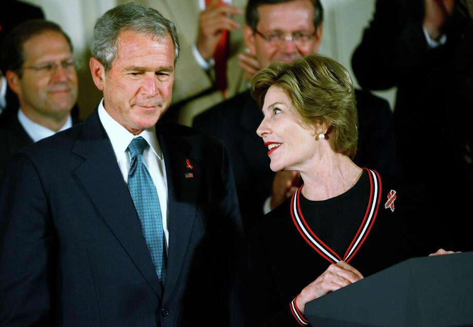 President George W. Bush signed the United States Global Leadership Against HIV/AIDS, Tuberculosis and Malaria Reauthorization Act of 2008 with first lady Laura Bush by his side. Photo: Chip Somodevilla, Staff / Getty Images North America
