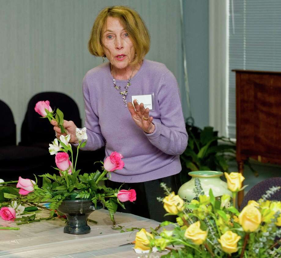 Pat Benkovich, a member of the Garden Club of Newtown and a winner of many ribbons in both creative design and horticulture, gives an arrangement demonstration to club members at the Newtown Library. Tuesday, Feb. 26, 2013 Photo: Scott Mullin / The News-Times Freelance