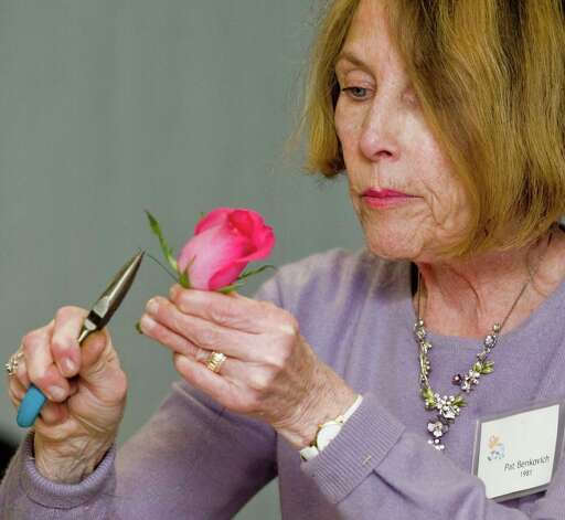 Pat Benkovich, a member of the Garden Club of Newtown, works on a corsage during her flower arrangement demonstration for club members at the Newtown Library. Tuesday, Feb. 26, 2013 Photo: Scott Mullin / The News-Times Freelance