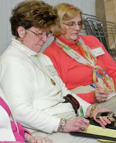Garden Club of Newtown members Marie Kasmarik and Marilynn Klepfer take notes during a flower arrangement demonstration by club member Pat Benkovich at the Newtown Library. Tuesday, Feb. 26, 2013 Photo: Scott Mullin