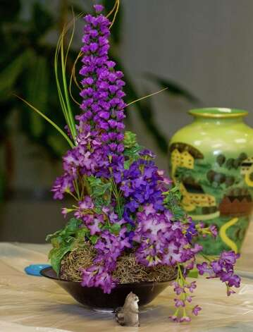 An arrangement of Liatris flowers by Garden Club of Newtown member Pat Benkovich, at the Newtown Library. Tuesday, Feb. 26, 2013 Photo: Scott Mullin