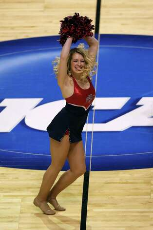 A cheerleader for the St. Mary's Gaels performs in the first half against the Memphis Tigers. Photo: Jonathan Daniel, Getty Images / 2013 Getty Images