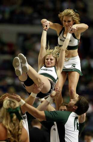Cheerleaders for the Michigan State Spartans perform against the Valparaiso Crusaders during the second round. Photo: Jonathan Daniel, Getty Images / 2013 Getty Images