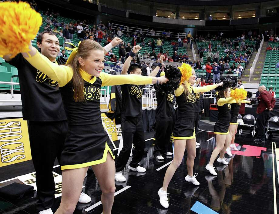 Wichita State cheerleaders preform before their game against Pittsburgh in a second-round game in the NCAA college basketball tournament in Salt Lake City Thursday, March 21, 2013. (AP Photo/George Frey) Photo: GEORGE FREY, Associated Press / FR10102 AP