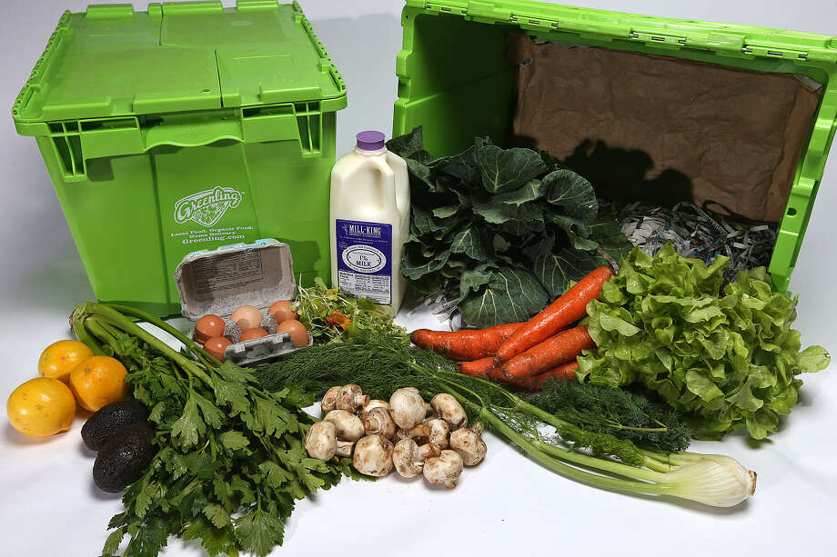 A delivery box from Greenling is filled with produce and other fresh products from local farms. Greenling also offers meal kits. Photo: Jerry Lara / San Antonio Express-News
